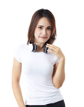Image of a happy young beautiful woman posing headphones listening music white background