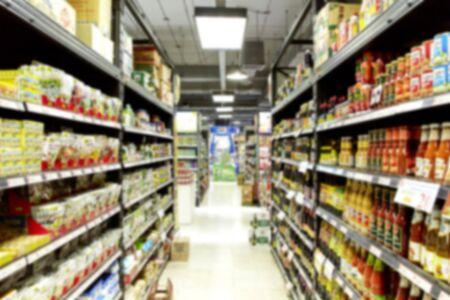 Empty blurry supermarket convenience store product shelf for background Reklamní fotografie