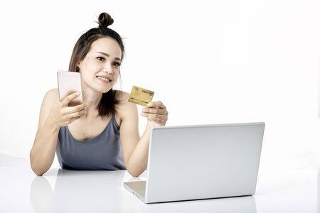 Asian woman shopping online studio shot on white