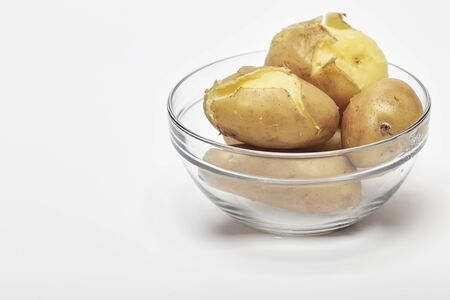 Boiled potatoes in a glass bowl on white background Banco de Imagens