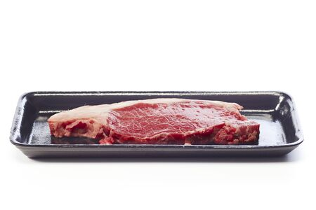 raw beef steak in vacuum package isolated on white background