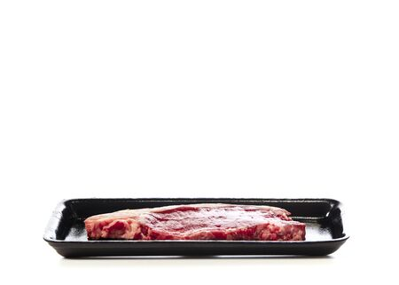 Raw beef steak in package isolated on white background Stock Photo