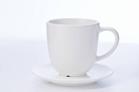 Empty white cup with sauser on white background, cup copy space for text 版權商用圖片