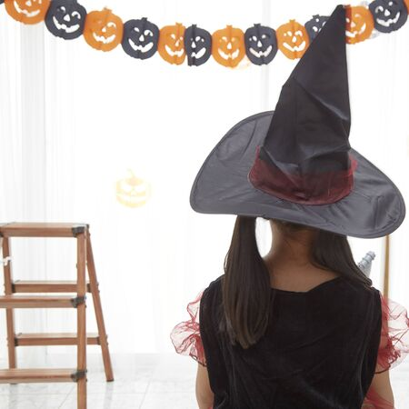 Happy Halloween. little beautiful girl in a witch costume 版權商用圖片