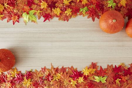 Autumn leaves and pumpkin on wooden background, copy space. Thanksgiving day 版權商用圖片