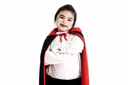 Little asian girl in halloween Scary Dracula costume on white background