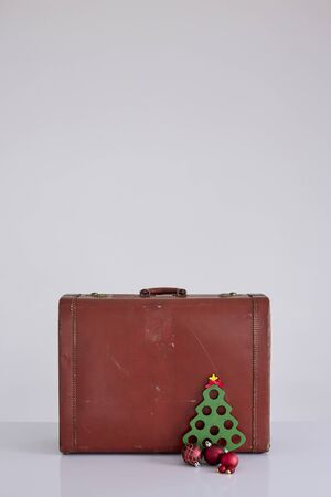 Vintage suitcase with Christmas decorations on white background. Christmas holiday concept