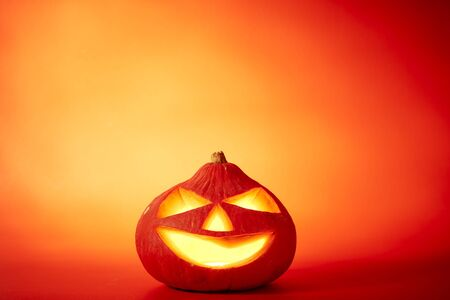 Halloween pumpkin head jack lantern with scary evil faces spooky holiday in the dark night