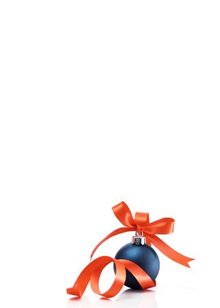 Blue christmas ball with red ribbon isolated on a white background. copy space for text. Winter decoration.