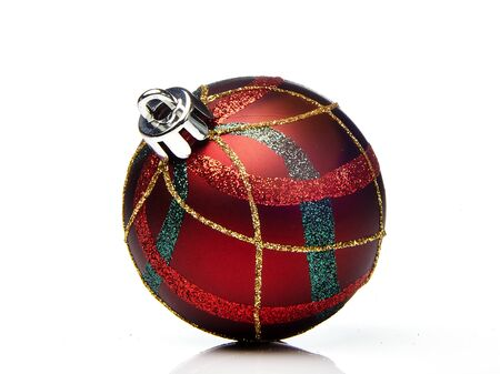 Studio shot of red christmas bauble over white background