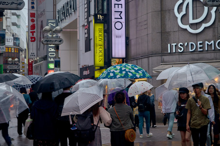 People in Hachiko Square, Shibuya shopping street on a rainy day, Shibuya is one of the most used pedestrians in the world.