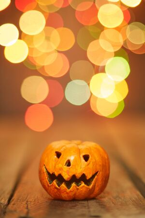 Halloween pumpkin on a bokeh lights background, copy space for text
