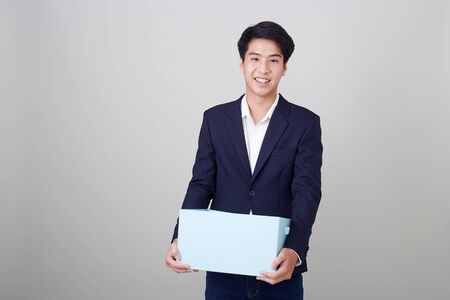Portrait of business man and holding paper box on white background