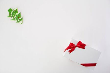 Pine Cookie and White gift box with red ribbon on white  on white background, Christmas, winter, new year concept. Flat lay, top view, copy space
