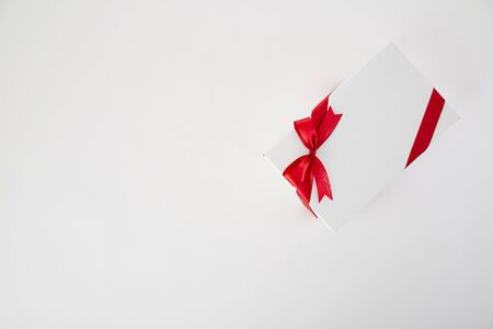 Red ribbon gift box on the white background. minimal christmas concept idea