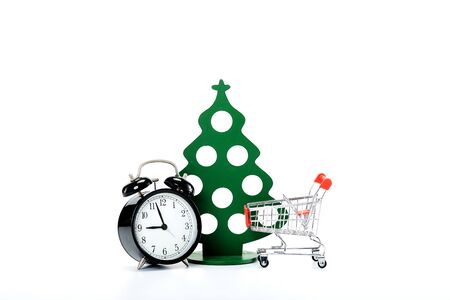 New Year with Merry Christmas festival shopping cart and black clock whtie background shopping cart and watch Product reduction