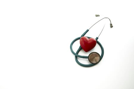 Close up of red heart and stethoscope on white background.  Medical Concept, world health day, copy space for text