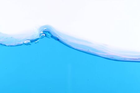 The surface of the blue water on white background, with space for text