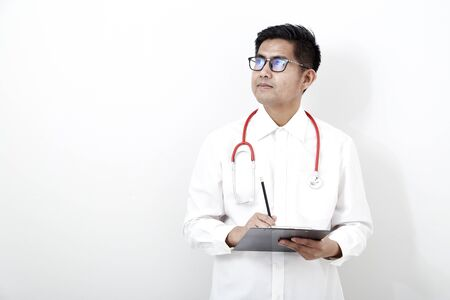 Smart handsome asian bearded medical doctor in glasses with stethoscope isolated on white background. health concept