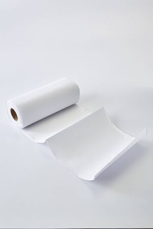 Toilet paper roll New Coronavirus on white background. Pandemic panic concept. Banco de Imagens