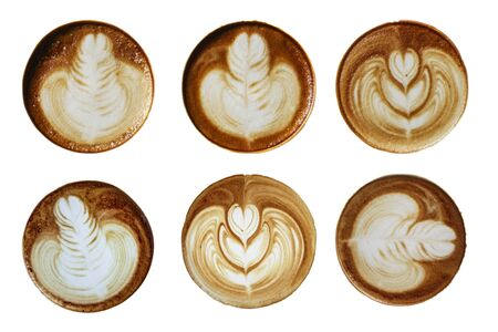 Top view of hot coffee latte foam design art isolated on white background.