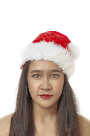 Pretty Young asian woman in christmas hat on white background