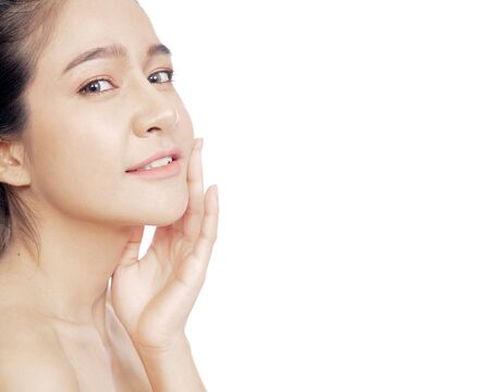 Close up young Thai woman beautiful face on white background for beauty and skin care concepts 写真素材