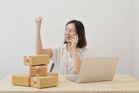 Happy young asian small business owner working at home office, Online marketing packaging delivery, startup SME entrepreneur or freelance woman concept Stock fotó