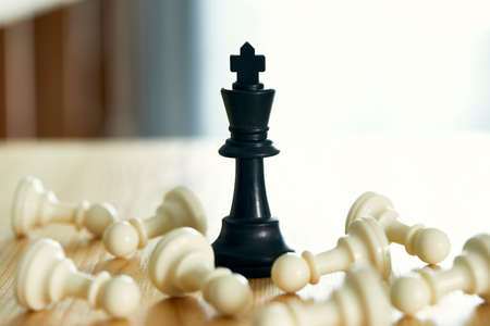 Chess king standing win on a wooden table, Leader success concept, win business concept