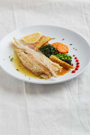 Tasty grilled Fish dish, fried fish fillet and vegetables