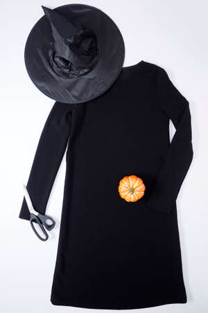 Top view black dress and wizard hat Fashion decoration for Halloween or Autumn background
