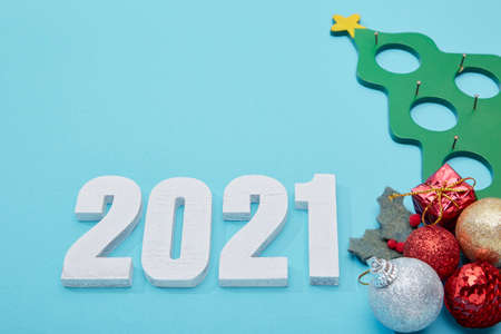 Happy new year number 2021 celebration for Christmas and New Year on pastel blue background Archivio Fotografico