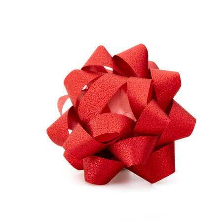Red lush bow on over white background