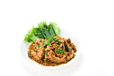 Thai food Spicy grilled pork neck salad served with fresh vegetable on white