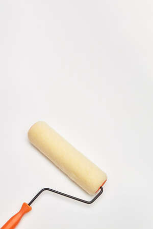 closeup painting roller tools work paint on white background Archivio Fotografico