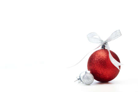 Red Christmas balls with silver ribbon on white background