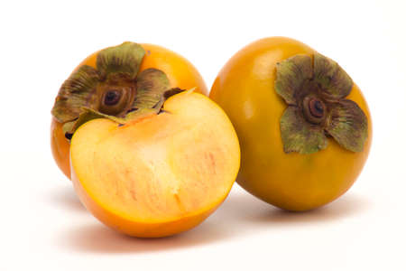 Fresh Ripe persimmon and Slice persimmon on white isolated background.