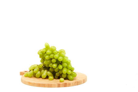 Green grapefruits a wooden cutting board white background, Flat lay