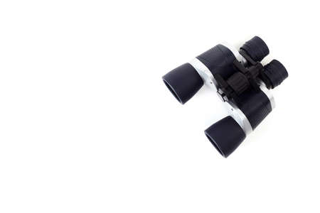 Binoculars set against a light white background, Flat lay, top view.