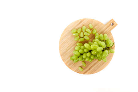 Green grapefruits a wooden cutting board white background, Flat lay top view