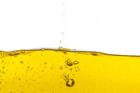 Beautiful wave of high viscosity of base oil and air bubble inside the oil isolated on white background. It was used in automotive and industrial application , used as wallpaper, industrial concept Reklamní fotografie