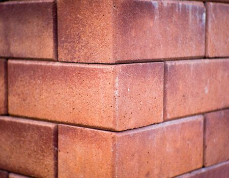 red brick: A corner of red brick wall