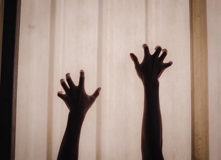 rising dead: Creepy hands crawling Stock Photo