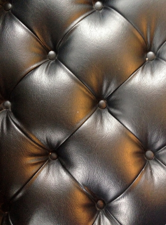 black leather fabric from the sofa