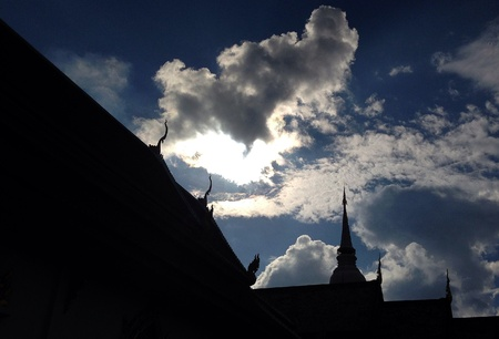 silhouette roof of church in Phra Singh Temple with sky Stock Photo