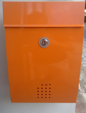 metal post: Orange metal post box