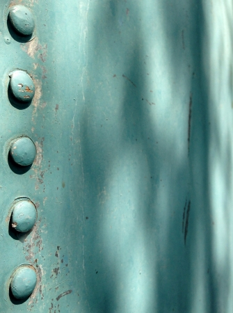 steel: Large bolt heads from an old water tank Stock Photo