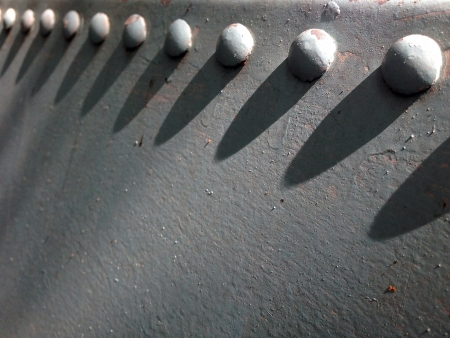 Large bolt heads from an old water tank Stock Photo