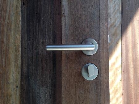 shiny metal: Modren style door handle on natural wooden door