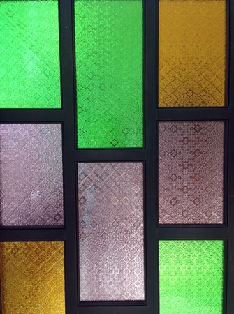 detail: stained glass window of colored glass